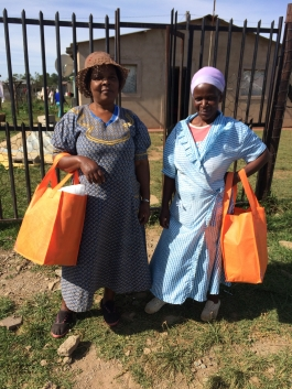 Lephina and Mavis proudly holding their knitting kits.